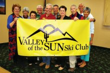 Left to right: Nancy Adams, Jane Sweet, Rose Geller, Ted McGovern, Lew Geller, Dave Geurden, Sharon Geurden, Lynn Warren, Jim Jarvis and Carol Jarvis hold the newly designed club banner.