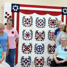 Placing of the finished blocks. From left back: Millissa Masters, Linda Labenz, Cathy Howell and Jean Fry; Seated: Cindy Santoro, Donna Wiznowski. From back right: Linda Shaver, Erma Taylor, Jackie Droncheff, Shirley Cushing and Jan Johnson; Seated Edna DeFord