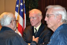Donald Critchlow, center, meeting with members after the program.