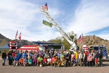 PebbleCreek Hiking Club members and guests at the annual winter picnic in front of the Fire Up Freedom Fire Truck in White Tanks Regional Park; photo by Lynn Warren.