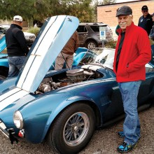 Wally Zink admiring a Shelby Cobra at the Toys for Tots car show in Wickenburg