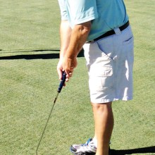Cliff Olson lines up his putting shot.