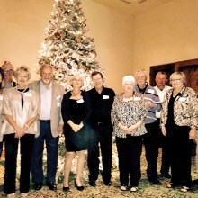 PCM9GA President and guests at holiday party, left to right: Luanne Brown, JoAnne Clements, PCM9GA President Ray Clements, Sandy Wold, Pat Moore, Maryanne Skirnick, Doug Wainwright, Linda Shaver