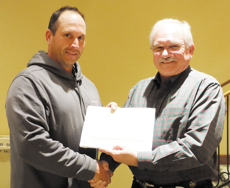 Paul McGinnis presents Employee of the Month award to Todd Drazkowski (left).
