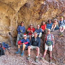 Left to right, front: Lynn Warren (photographer), Tom Wellman, Gary Bray; rear: Mark Frumkin, Steve Duncanson, Les Reister, Nancy Love, Jim Gillespie, Julie Walmsley and Clare Bangs sheltered from a cool breeze by a large overhang next to the double arches.