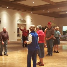 PebbleCreek Singles learn to Square Dance at their Oktoberfest.