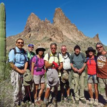 Left to right: Ed Kim, Lynn Warren (photographer), Beverly Kim, Mark Frumkin, Mark Gruca, Len Jeffery, Vicki Carter and Gary Bray pausing shortly after lunch with Eagletail Peak in the background.