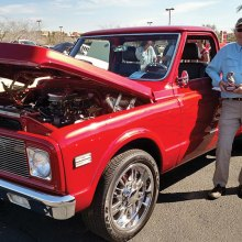 PebbleCreek Car Club member Dave Byerley was presented a trophy for Best of Show for trucks 1967 - 1980 at the Veterans Tribute Car Show February 25 at Westgate Entertainment District. Dave's 1972 Chevy long bed pick-up is blaze red crystal pearl with purple flames.