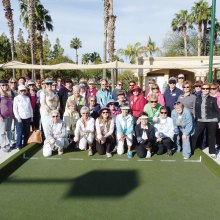 Participants in the March 4 Female Bocce Tournament gather at the Eagle's Nest Courts to select teams by way of a blind draw.