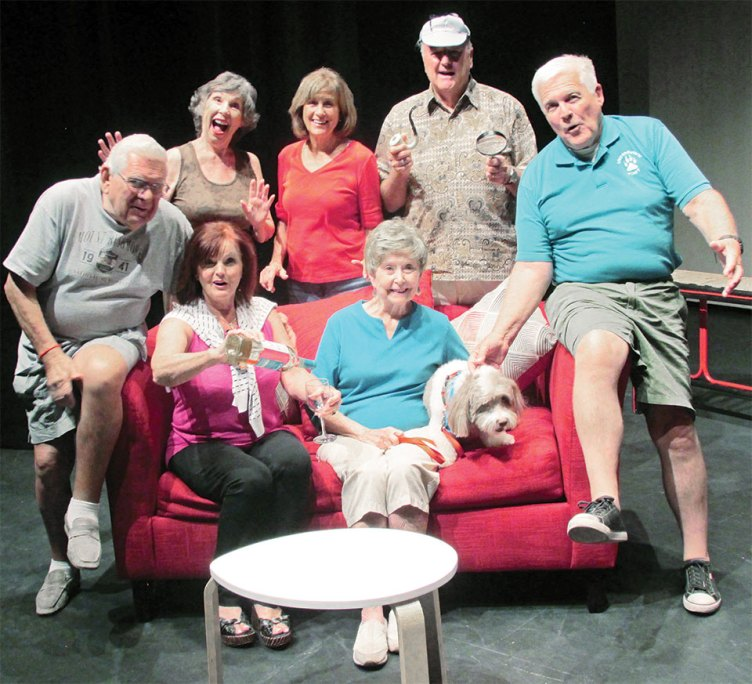 The Game's Afoot cast members enjoying laughs before rehearsal, left to right standing: Laurie Overson, Donna Gray, Ray Haden; seated: John Gimon, Sophie Shrum, Shirley Robinson, Chip the dog and Jon Lindstrom. Missing from photo is Judi Blankenship.