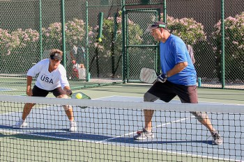 Andrea Dilger and Rick Watson concentrate on covering the middle of the court; Photo by Dannie Cortez.