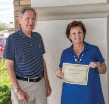 Lyle Chrisman, Club President, presented a Certificate of Achievement to Marianne Moir.
