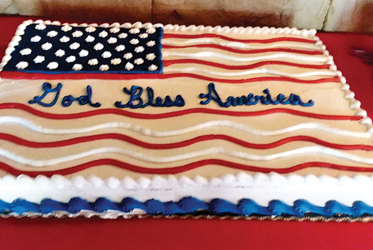 Barb Guthier and Barbie Bennewate, who checked in members and guests, toasted our president. An American flag carrot cake was a special treat after dinner and during the president's announcement.