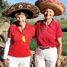 Co-captains Sue White and Judi Floyd plan the Red Hot Sombrero Frolic.
