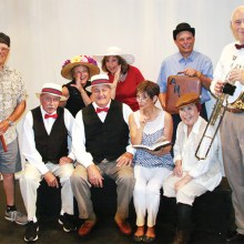 Cast members include (left to right): John Fuhrmann (Marcellus), Dan Baker and Ray Hadden (school board Members), Donna Prinz and Shotzie Workman (Pick-A-Littles), Nancy Davis (Marian), Susie Moy (Winthrop), Chuck Kelly (anvil salesman), and Jack Coate (Professor Hill).