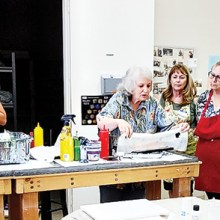 Some of the participants in the Aug. 8 Acrylic Pour Painting 101 class.