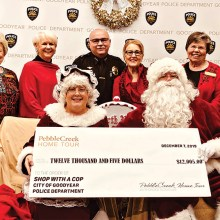 """Back row (left to right): Wally Campbell; Suzanne Butler; Deputy Chief of Police Santiago """"Jimmy"""" Rodriguez; Barbara Hockert, and Charlotte Krause; front row: Mrs. Claus and Santa"""