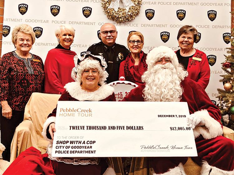 "Back row (left to right): Wally Campbell; Suzanne Butler; Deputy Chief of Police Santiago ""Jimmy"" Rodriguez; Barbara Hockert, and Charlotte Krause; front row: Mrs. Claus and Santa"