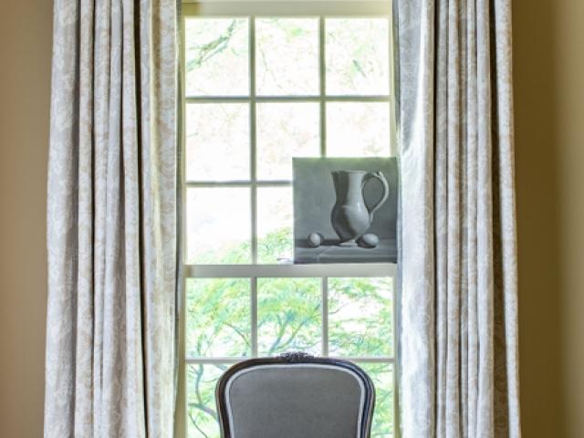Beretania Circle Residence 8 grey tan window grey velvet chair long drapes Pebbles Nix Interiors