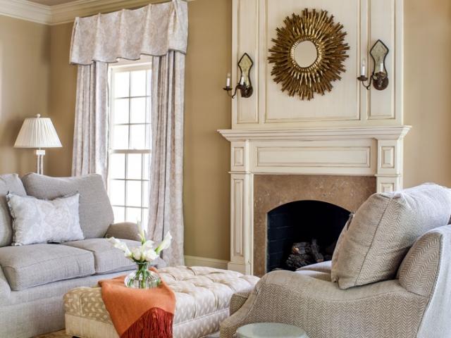Beretania Circle Residence 9 family room grey tan fireplace tufted ottoman Pebbles Nix Interiors
