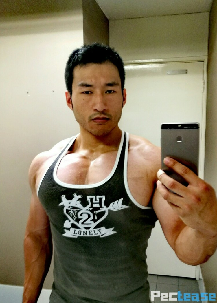 More mystery muscle pec cleavage in green tank top
