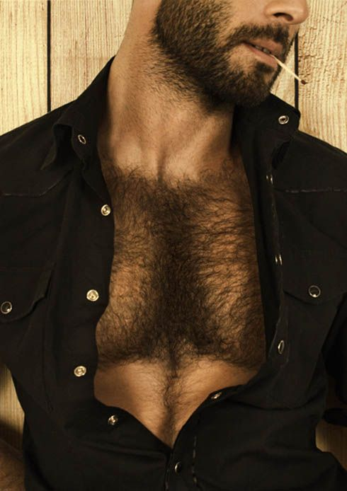 Man in open black shirt with lots of chest hair.