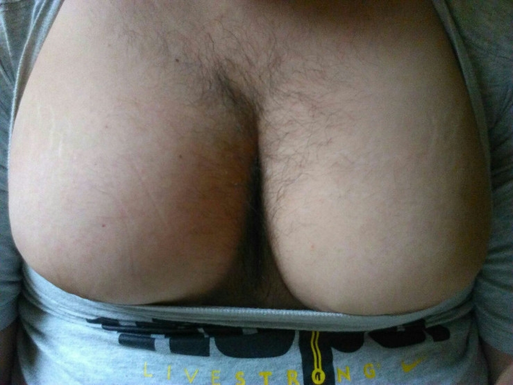 Huge hairy moob cleavage propped all the way up in stretched shirt
