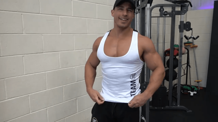 Mike Thurston hands on hip in sexy tank top