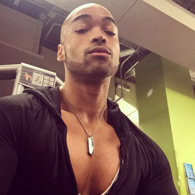 David Singletary sweating and showing his pecs in a hoodie good view of cleavage