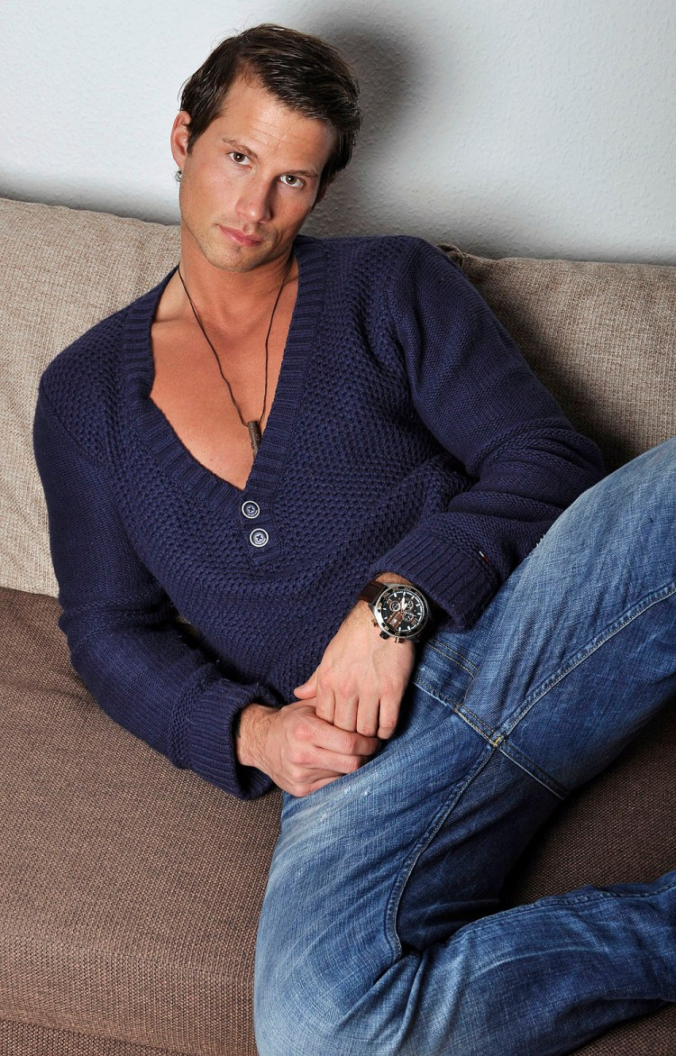 Phil N. seductively reclined on couch in cardigan