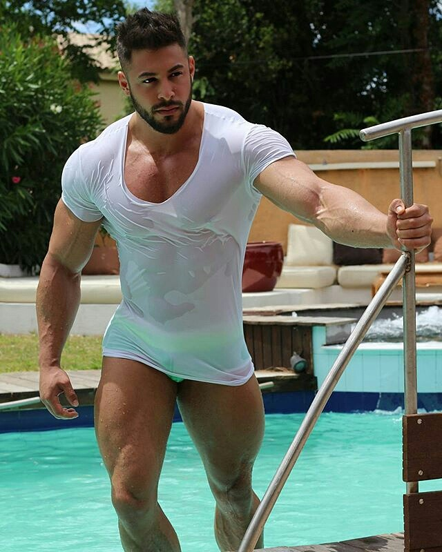 Dragos Syko emerging from the pool in wet V-neck