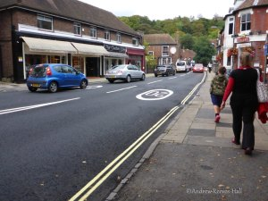Roundels in the road remind people of the 20mph speed limit.