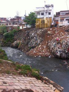 Trash along Assi tributary