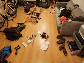 All our crap laid bare in Andy's friends' house. Thanks Andy's friends.
