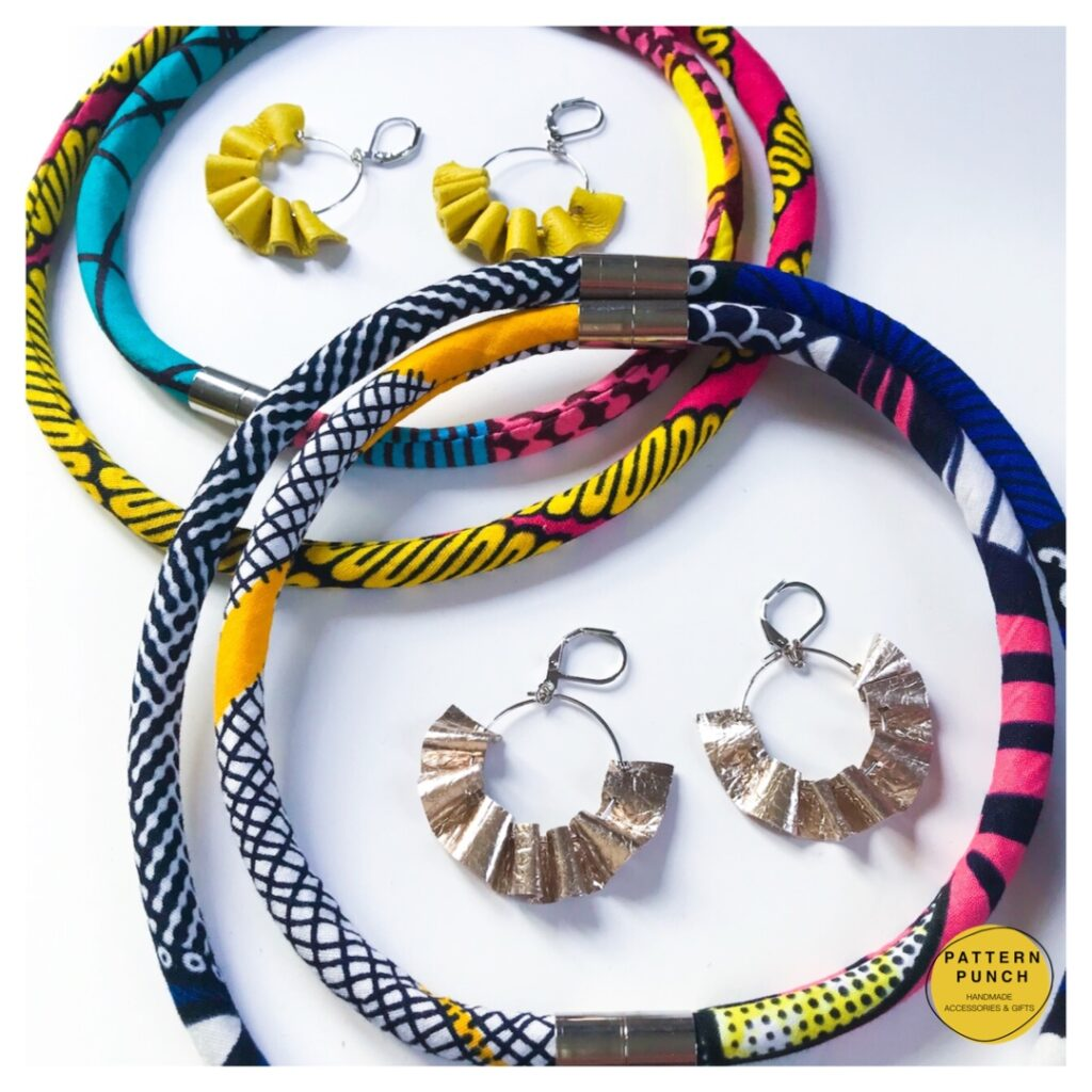 Rope necklace and leather earring sets displayed together. Pattern Punch