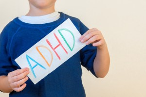 Child holding adhd sign
