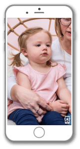 toddler with mother in a virtual appointment on iphone