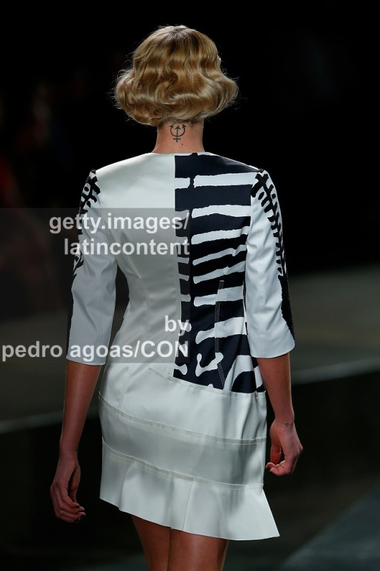 SAO PAULO, BRAZIL - MARCH 21: A model walks down the runway showing a design by Amap™ during S‹ão Paulo Fashion Week (SPFW) Summer 2013/2014 on March 21, 2013 in S‹o Paulo, Brazil. (Photo by Pedro Agoas/LatinContent/Getty Images)