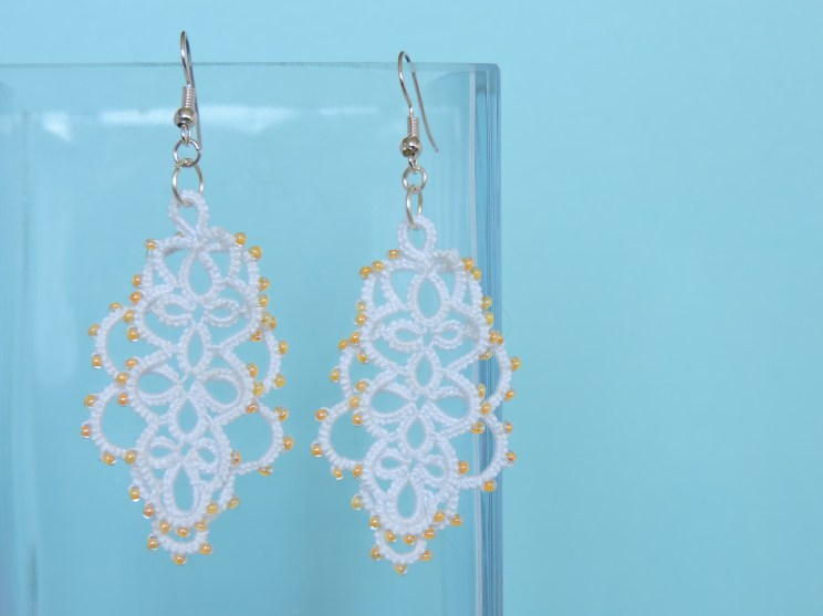 Elegant Layered Lace with Yellow Bead Detail