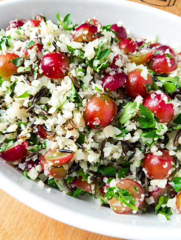 Bright and pretty, this recipe combines low carb cauliflower rice with a wild rice to give the perfect balance between low carb and great texture. Gluten, dairy, egg, nut free. Make ahead easy dinner side dish that is Wahls, AIP, Whole30 and Paleo. Vegan. peelwithzeal.com