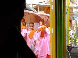 Lady monks on the way to their daily bargain