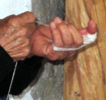 8.11 woman pulling apart silk fibers