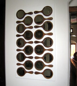 Another fanciful motif seems to be mirrors. Here in one composition of mirrors we came across.