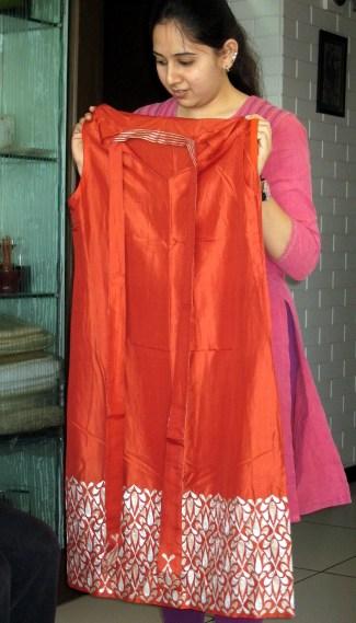 4.4 girl holding red dress
