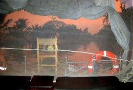 6.3 sunset on our boat covered with mosquito netting