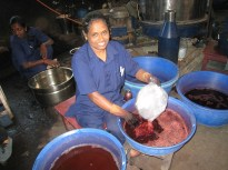 9.6 woman with red dye pot