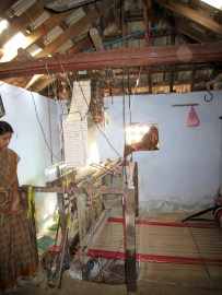 18.12 woman standing by loom