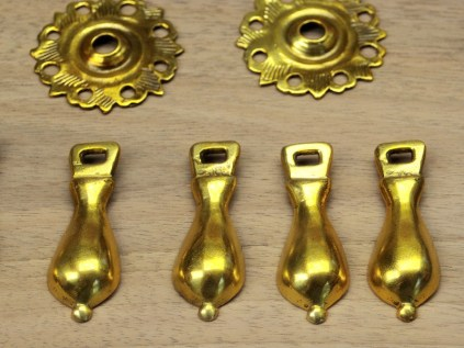 Gold-lacquered pear drop handles.