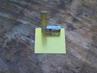 Off-cut of brass sheet.