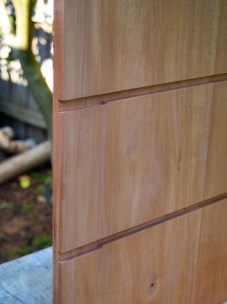 Narrow dustboard trenches with wider, dovetailed divider housings.